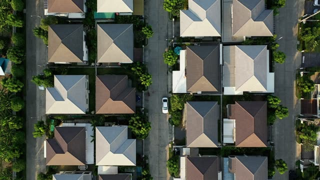 Aerial drone image of residential suburban houses in a small community.