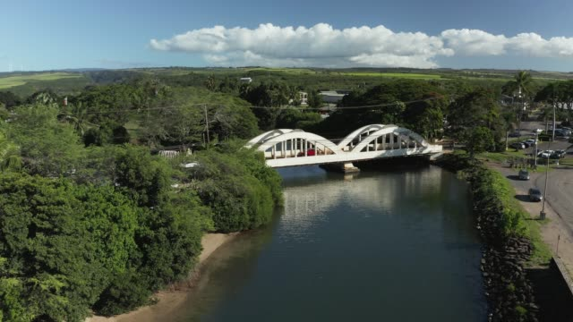 Aerial drone motion towards twin arched bridge over the river Anahulu in Haleiwa on Oahu - video