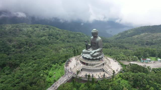 Aerial Drone Movie of Big Bhudda Statue in Foggy and Clouldy Day, Ngong Ping 360, Hong Kong