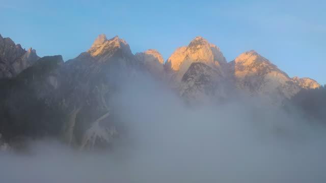aerial drone movie of sunrise scene with morning fog around gosauseen lake, splendid morning view of austrian alps, upper austria, europe - stato federato del tirolo video stock e b–roll