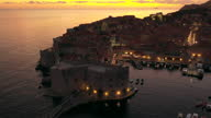 istock Aerial Drone Movie Sunset Scene of Dubrovnik Old City in the Mediterranean Sea, Southern Croatia. Dubrovnik joined the UNESCO list of World Heritage sites. 1283204507