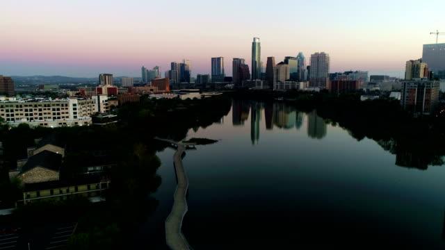 Aerial Drone over Pedestrian Bridge Austin Texas Mirror image sunrise belt of venus colors video