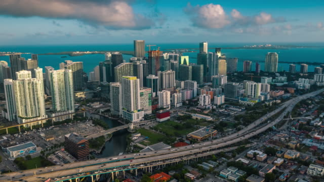 MIAMI, FLORIDA, USA - JANUARY 2019: Aerial drone panorama view flight over Miami downtown. Tall buildings from above. MIAMI, FLORIDA, USA - JANUARY 2019: Aerial drone panorama view flight over Miami downtown. Streets, hotels and residential buildings from above. south stock videos & royalty-free footage