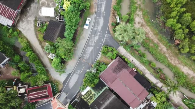 Aerial drone point of view of local road along the rural scene