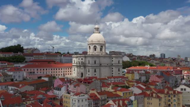 vídeos de stock e filmes b-roll de aerial drone rotating shot of a church in lisbon - portugal