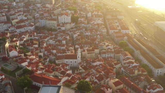 vídeos de stock e filmes b-roll de aerial drone rotating shot of a church in lisbon - lisbon