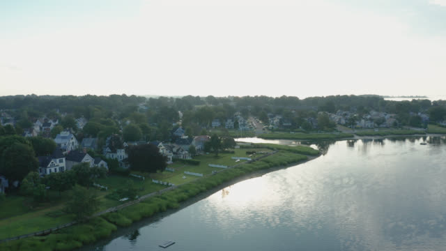 Aerial Drone Shot Ascending to Reveal a Suburban Coastline Neighborhood (Norwalk, Connecticut) Aerial Drone Shot Ascending to Reveal a Suburban Coastline Neighborhood (Norwalk, Connecticut) - Shot on DJI Mavic 2 Pro on August 4, 2019 connecticut stock videos & royalty-free footage
