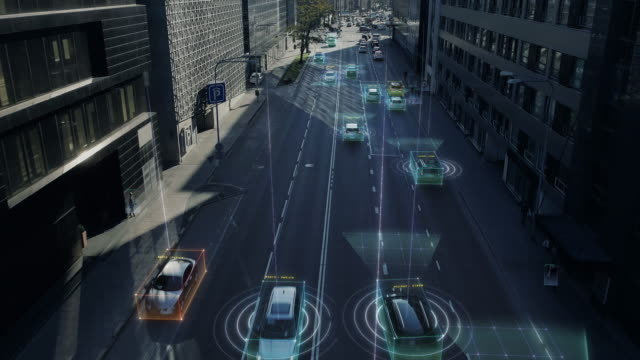 Aerial Drone Shot: Autonomous Self Driving Cars Moving Through City. Concept: Artificial Intelligence Scans Surrounding Environment, Detecting Cars, Pedestrians, Avoids Traffic Jams and Drives Safely.