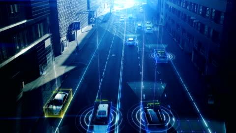 vídeos de stock e filmes b-roll de aerial drone shot: autonomous self driving cars moving through city. concept: artificial intelligence scans cars and pedestrians, following movement and showing data. - transporte assunto