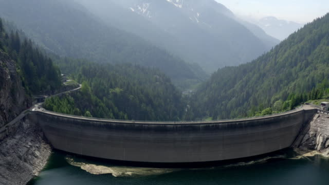 Aerial drone shot circling above a large dam in Sambuco Switzerland