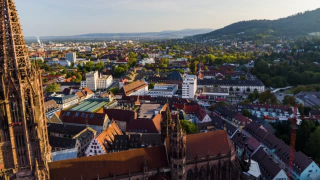 vídeos de stock e filmes b-roll de aerial drone shot near an old town with gothic church near freiburg - alemanha