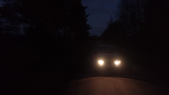aerial drone shot of 4x4 driving in night - wiejska droga filmów i materiałów b-roll