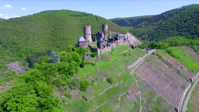 Aerial drone shot of a chateau on a hill in Mosel