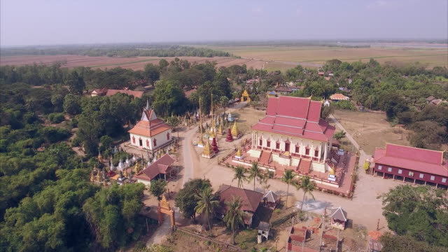Aerial drone shot of a traditional pagoda with small village around Aerial drone shot of a traditional pagoda with small village around back to back stock videos & royalty-free footage
