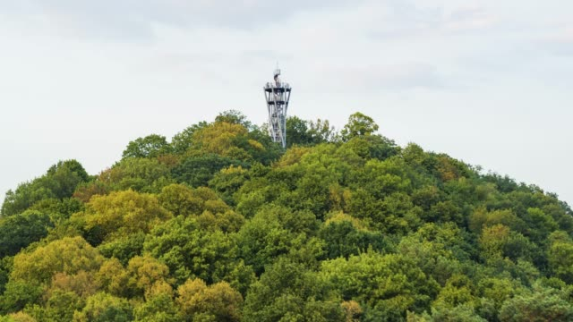 aerial drone shot of an observation tower on a hill near freiburg - эскапизм стоковые видео и кадры b-roll