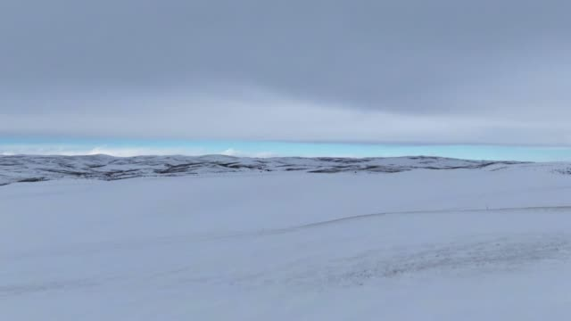 Aerial Drone Shot of an Overcast, Snowy, Hilly Landscape outside of Craig, Colorado