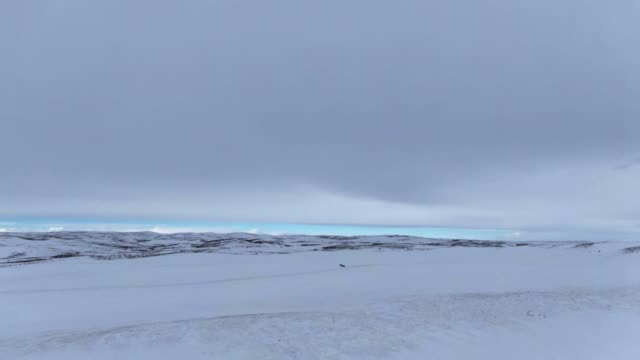 Aerial Drone Shot of an Overcast, Snowy, Hilly Landscape outside of Craig, Colorado Aerial Drone Shot of an Overcast, Snowy, Hilly Landscape outside of Craig, Colorado general view stock videos & royalty-free footage