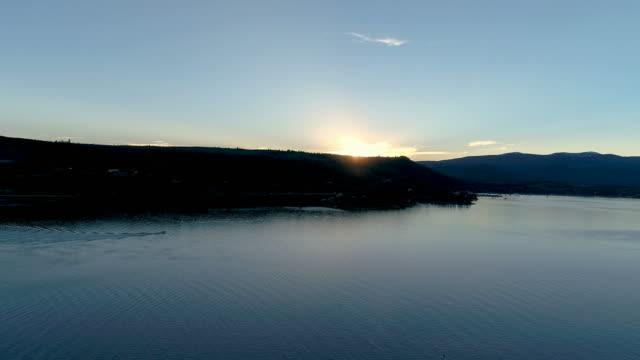 Aerial drone shot of Colorado mountain lake at sundown video