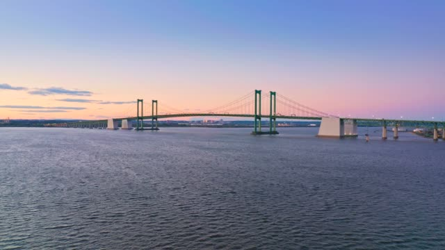 Aerial drone shot of Delaware Memorial Bridge at dusk.