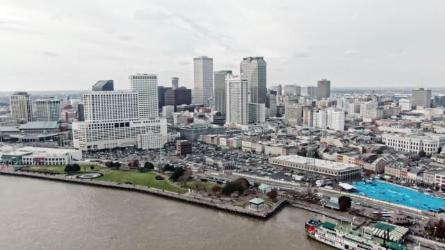 Aerial Drone Shot of Downtown New Orleans/French Quarter Skyline from the Mississippi River under an Overcast Sky