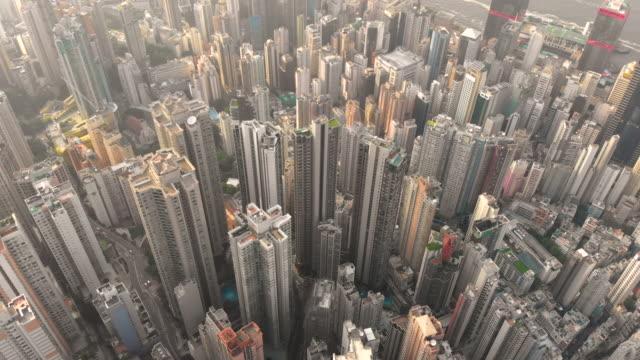 aerial drone shot of hong kong building - wielki filmów i materiałów b-roll