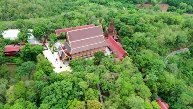 Aerial Drone shot of Neramit Wipatsana temple is famous a large ordination hall and pagoda made from red colored laterite (thai call si la laeng),Loei,Thailand