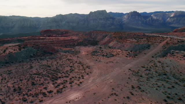 aerial drone shot of red rock canyon national conservation area and quarry next to las vegas, nevada - red rock canyon national conservation area video stock e b–roll