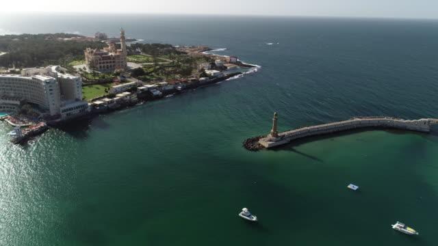 Aerial Drone shot over Egypt Alexandria City sea - Montazah Palace - Light house