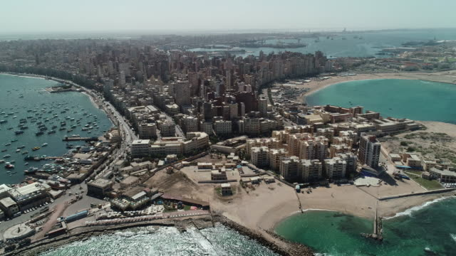 Aerial Drone Shot over Egypt Alexandria City sea - The Citadel of Qaitbay Aerial Drone Shot over Egypt Alexandria City sea - The Citadel of Qaitbay egypt stock videos & royalty-free footage