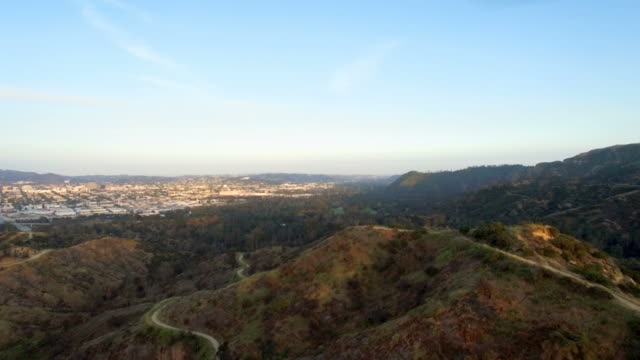 Aerial drone shot over Griffith Park trail in Los Angeles, CA video