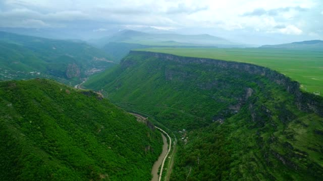 Aerial drone shot over the beautiful green canyon and plateau in Armenia. 4K video