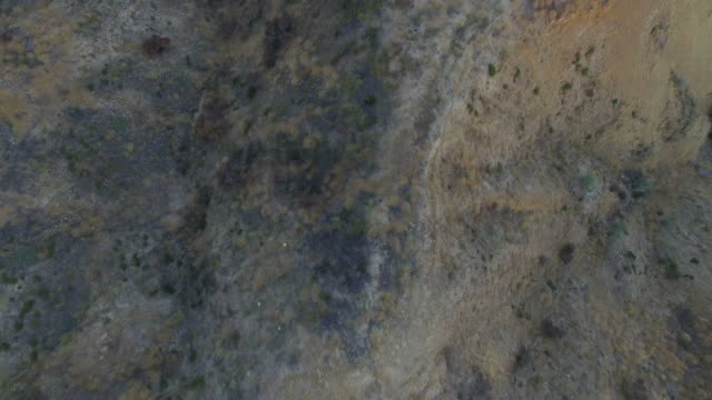 Aerial drone straight down view of desert hills landscape video