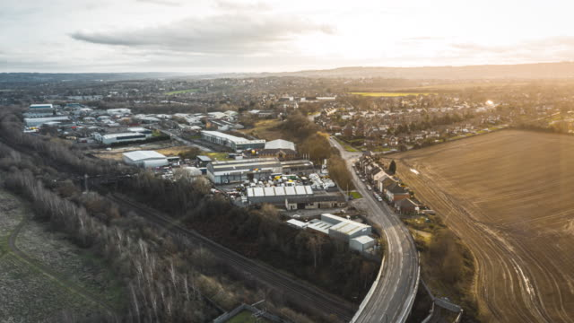vídeos de stock e filmes b-roll de aerial drone time-lapse over sheffield city industrial estates, south yorkshire at sunset winter 2019 - passagem de ano