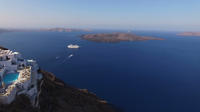 Aerial drone video of Santorini volcanic island on a summer morning, Cyclades, Greece Santorini island is well known for unmached beauty with panoramic views of the caldera and the sunset. Situated in Cyclades it is one of the most visited islands in Greece all year long greek islands stock videos & royalty-free footage