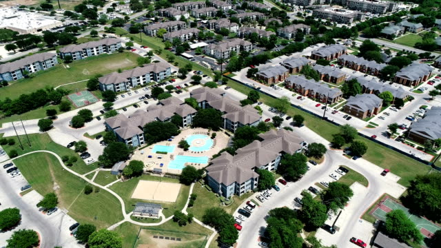aerial drone view Apartment complex aerial view above new development condo living - San Marcos , Texas , USA backing away Apartment complex aerial view above new development condo living - San Marcos , Texas , USA complexity stock videos & royalty-free footage