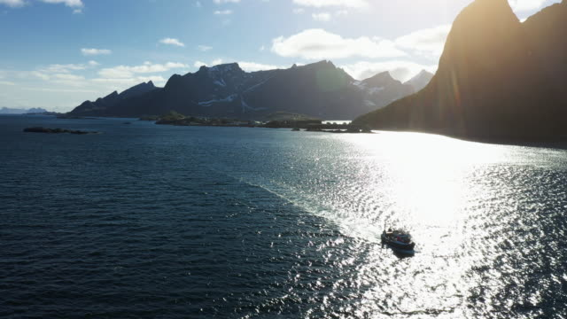 Aerial drone view: fishing boat at Lofoten Islands in Norway
