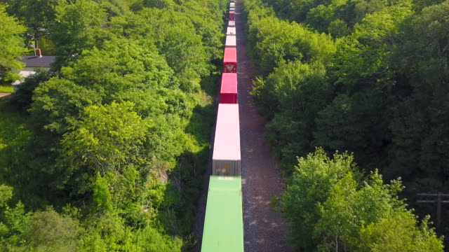 Aerial Drone View: Freight Train Low-level aerial drone view of a freight train. cargo container stock videos & royalty-free footage