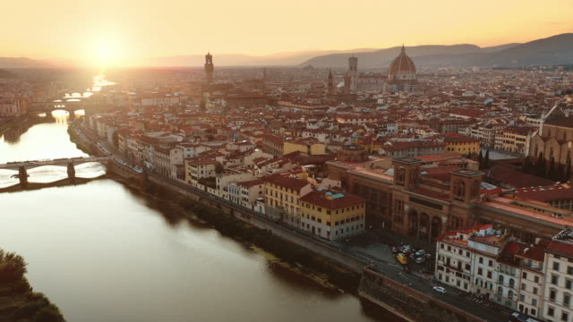Aerial Drone View: Historically and Culturally Rich Italian Town on the Sunny Day. Beautiful Old City With Medieval Churches and Cathedrals. River Runs through the City