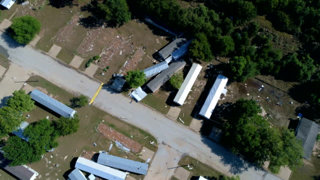 aerial drone view lowering la grange , texas small town gulf coast damage zone from hurricane harvey path of destruction. - gulf coast states stock videos & royalty-free footage