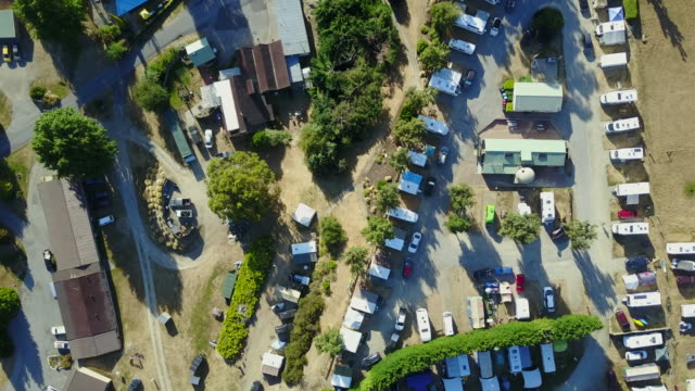 aerial drone view of campsite or campground, camping pitch place used for overnight stay in outdoor area for camper vans and caravans. - caravan stock videos & royalty-free footage
