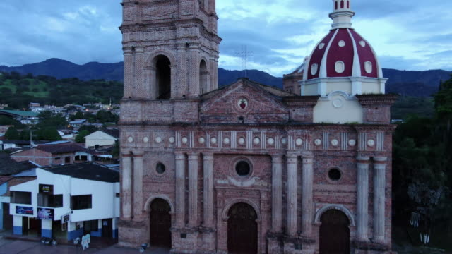 Aerial drone view of cathedral in small town in the countryside of Colombia