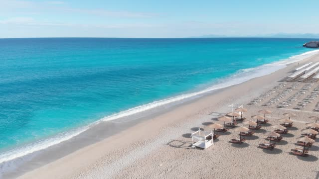 Aerial drone view of Kathisma beach in the morning, Lefkada island, Greece Aerial of the amazing Kathisma beach in Lefkada island, Greece greek islands stock videos & royalty-free footage