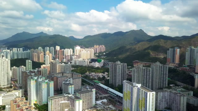 Aerial drone view of Sha Tin district with Shing Mun river