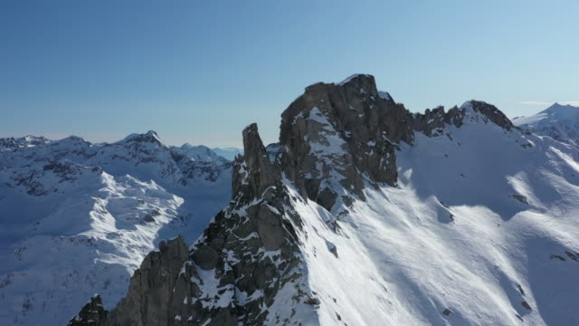 Aerial drone view of snow capped mountains Winter alpine exploration in Bedretto Valley of Ticino, Switzerland snowcapped mountain stock videos & royalty-free footage