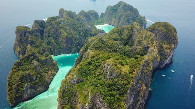 Aerial drone view of tropical Maya Bay and limestone cliffs, Phi Phi islands, Thailand