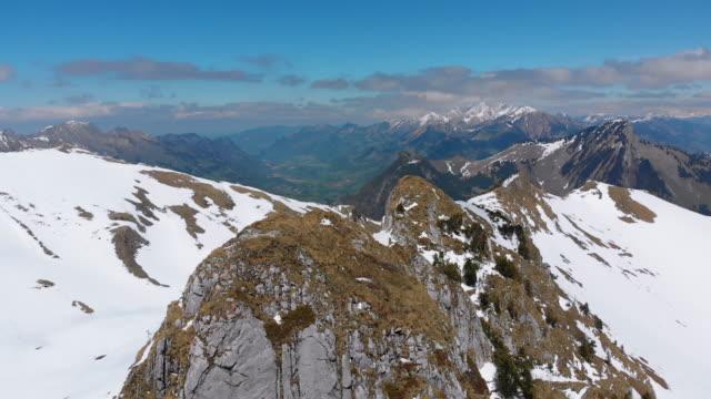 Aerial Drone view on Snowy Peaks of Swiss Alps. Switzerland. Rochers-de-Naye mountain peak