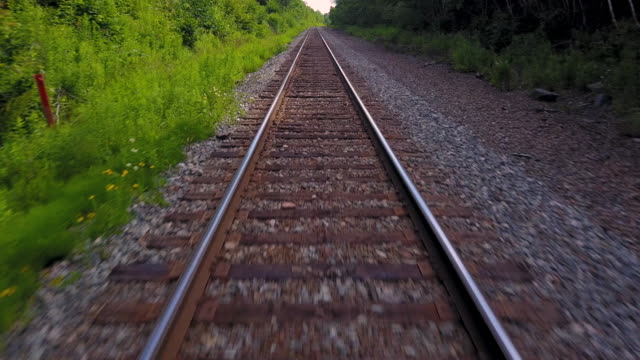 Aerial Drone View: Railroad Tracks Low-level aerial drone view of railroad tracks. tramway videos stock videos & royalty-free footage