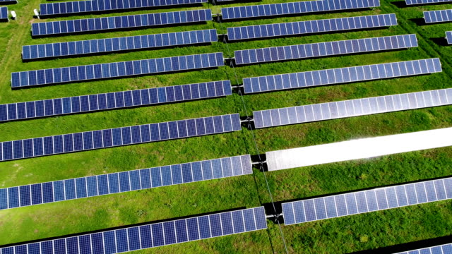 aerial drone view solar panels sun reflecting off panels austin , tx - sustainability video stock e b–roll