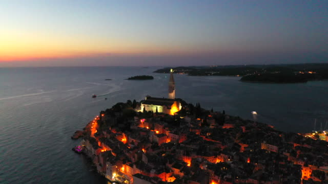 Aerial Drone View Sunset Scene of historical center of Rovinj old town, Istria region, Croatia, Europe
