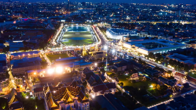 Aerial Dusk to Night Time Lapse or Hyper Lapse of Grand Palace, Bangkok